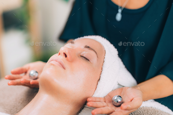 Face Lymphatic Drainage with Chinese Meditation Balls - Stock Photo - Images