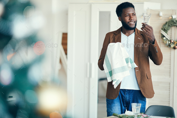 African Man Preparing for Christmas Dinner - Stock Photo - Images