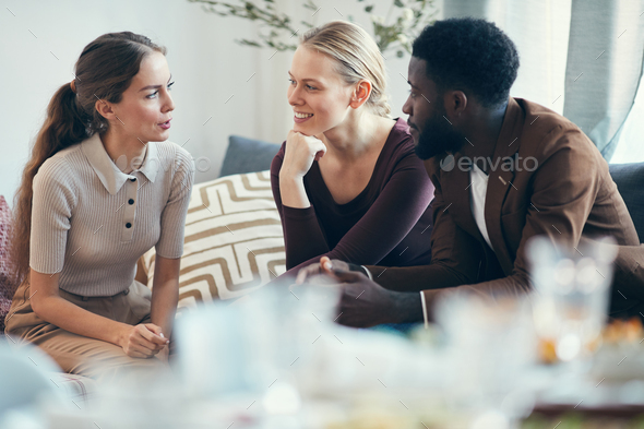 Friends Chatting at Christmas Party - Stock Photo - Images
