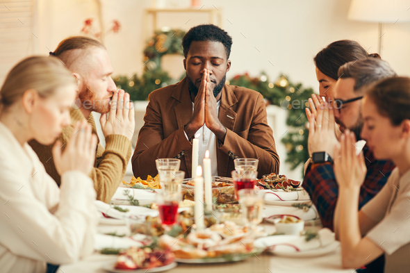 Saying Grace at Dinner Table - Stock Photo - Images