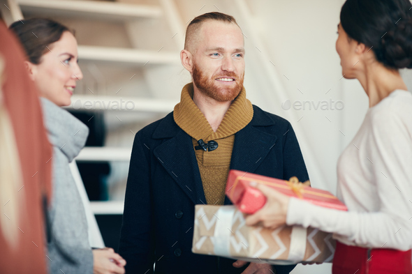 Welcoming Friends for Christmas Party - Stock Photo - Images