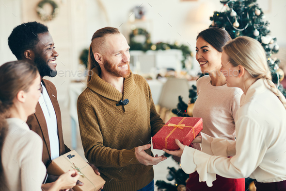 Exchanging Christmas Presents - Stock Photo - Images