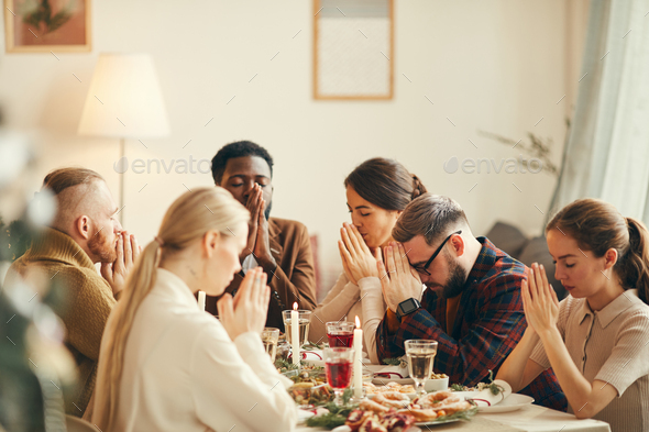 Saying Grace at Christmas Dinner - Stock Photo - Images