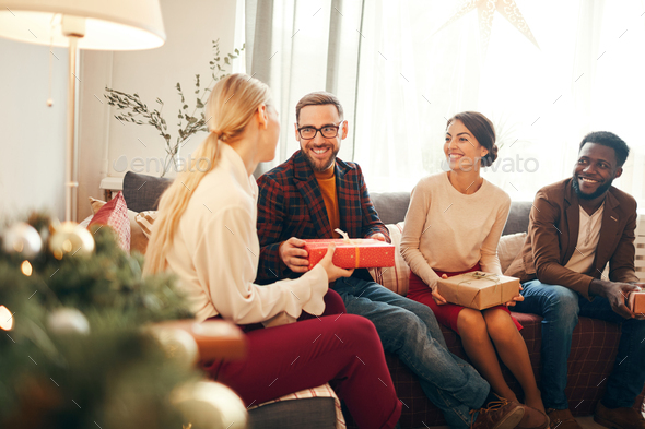 Presenting Christmas Gift - Stock Photo - Images
