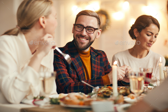Guests Enjoying Dinner on Christmas - Stock Photo - Images