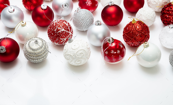 Xmas baubles close up against white background - Stock Photo - Images