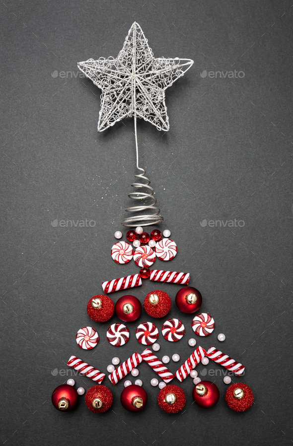 Xmas baubles in tree shape against black background, top view - Stock Photo - Images