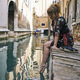 Redhead girl with floral dress sitting near venice canal bare feet - PhotoDune Item for Sale