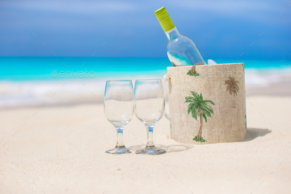 Bottle of white wine and two glasses on the exotic sandy beach - Stock Photo - Images