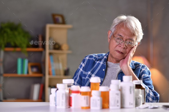 Senior man with pill - Stock Photo - Images