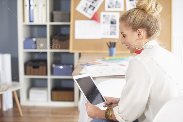 Happy woman staring at digital tablet - Stock Photo - Images
