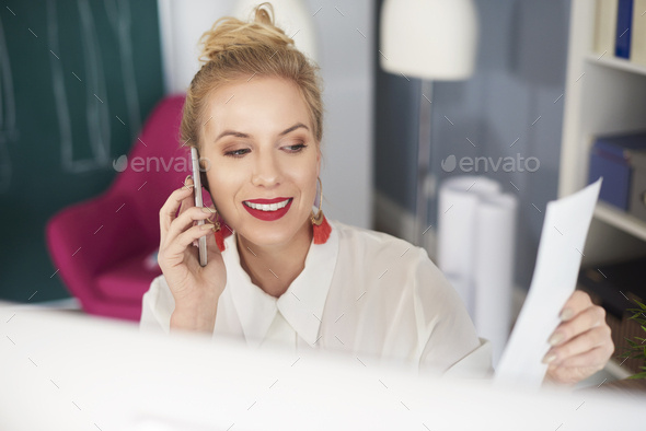 Front view of woman talking by the phone - Stock Photo - Images