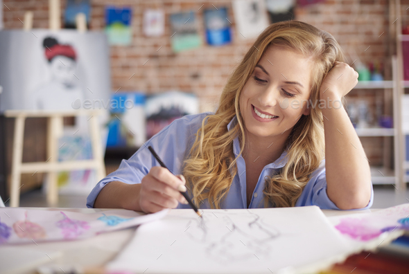 Woman working on a clothing design - Stock Photo - Images