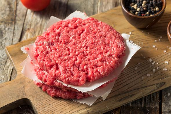 Raw Red Organic Hamuburger Pattys - Stock Photo - Images