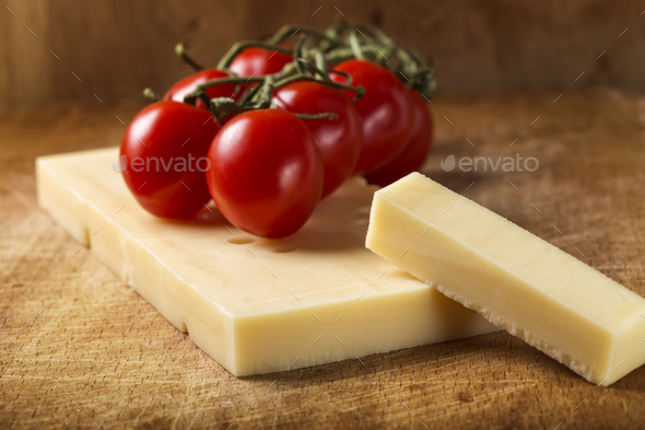 Emmental cheese with cherry tomatoes - Stock Photo - Images