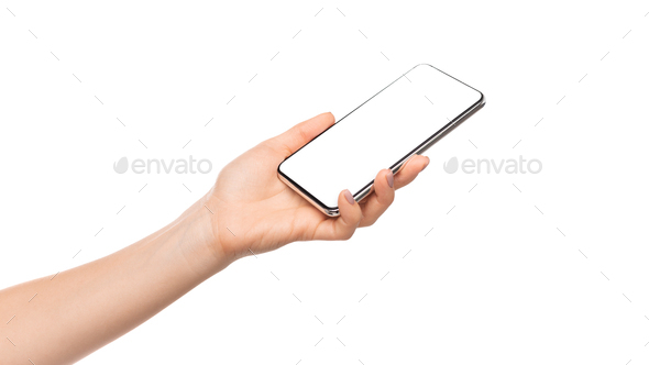 Woman's hand presenting modern smartphone with blank screen - Stock Photo - Images