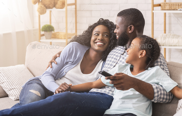 Cheerful Black Family Having Fun Together Watching TV Show - Stock Photo - Images