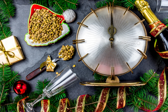 Hispanic New year eve tradition eat spoon of lentil - Stock Photo - Images
