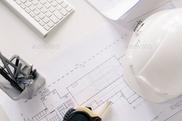Overview of working supplies of contemporary engineer on desk - Stock Photo - Images