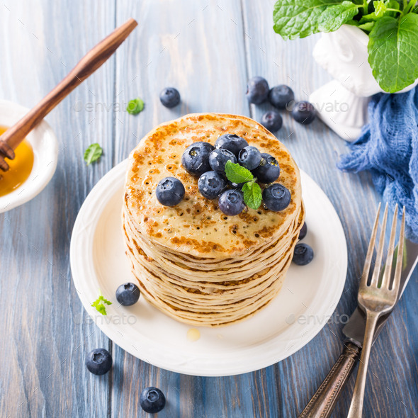 Delicious pancakes with fresh blueberries - Stock Photo - Images