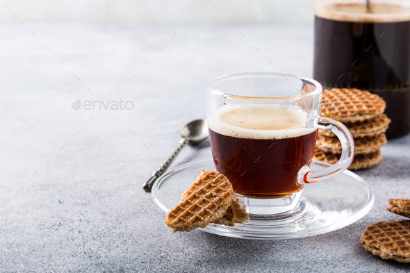 Glass cup of coffee with syrupwaffles cookies - Stock Photo - Images