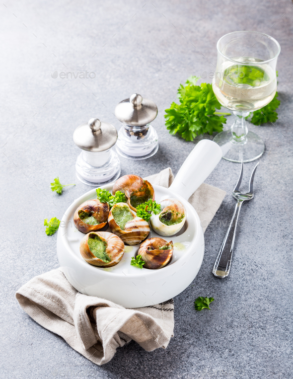 Snails with garlic herbs butter - Stock Photo - Images