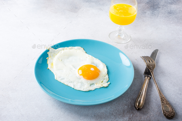 Fried egg and orange juice - Stock Photo - Images