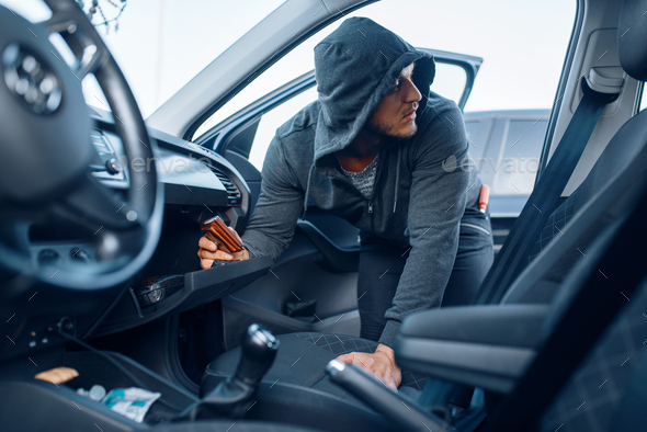 Car robber takes the wallet, stealing - Stock Photo - Images