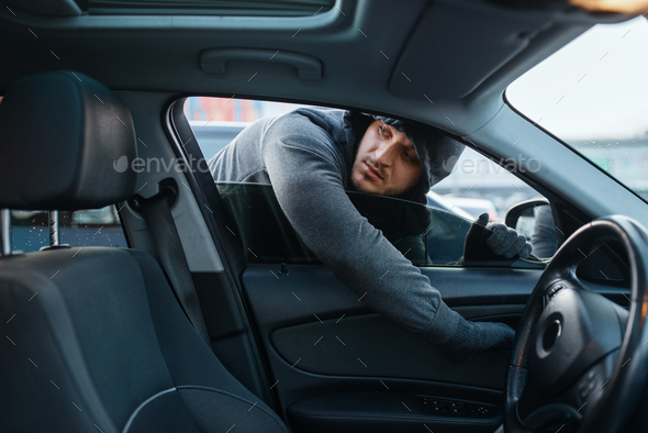 Car robber opening door, risk job, stealing - Stock Photo - Images