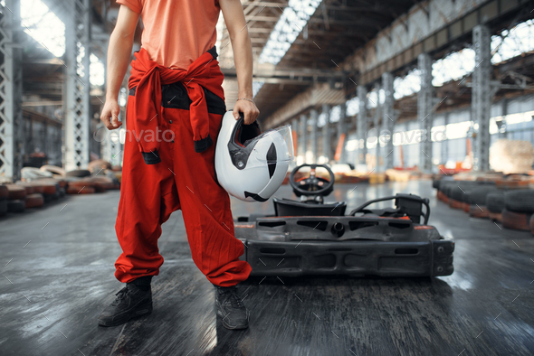 Racer with helmet, go kart car on background - Stock Photo - Images