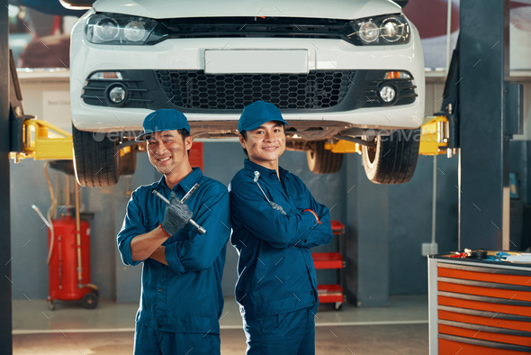 Mechanics working in auto service - Stock Photo - Images
