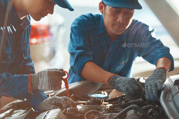 Auto mechanic working in garage - Stock Photo - Images