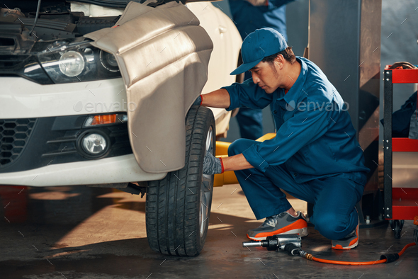 Wheel replacement in service - Stock Photo - Images