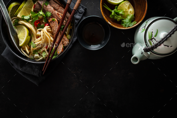 Tasty asian classic soup with noodles and meat - Stock Photo - Images