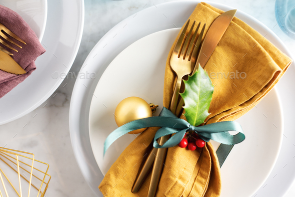 Christmas cutlery with napkin on plate - Stock Photo - Images