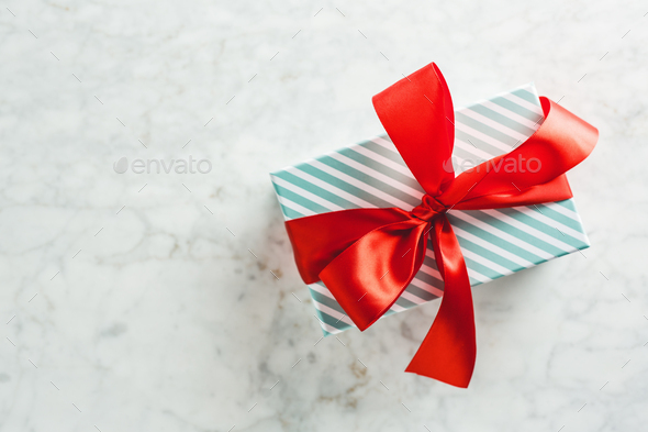 Modern wrapped gift on bright table - Stock Photo - Images