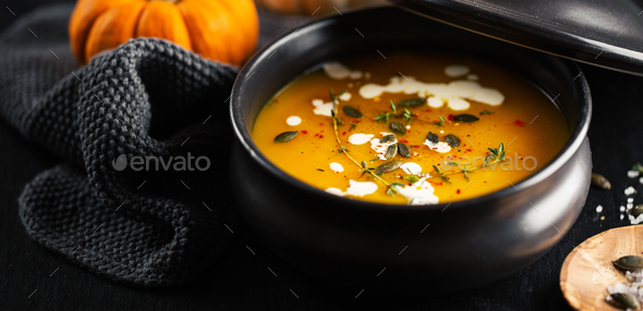 Creamy pumpkin soup served in bowl - Stock Photo - Images