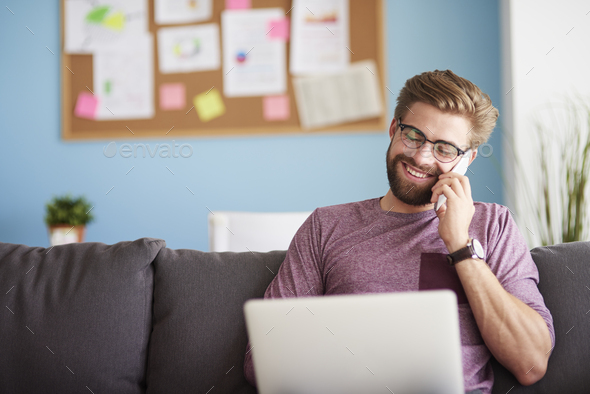 Happy man working at home - Stock Photo - Images