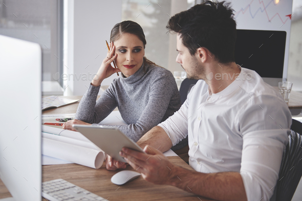 Couple looking forward to productive cooperation - Stock Photo - Images