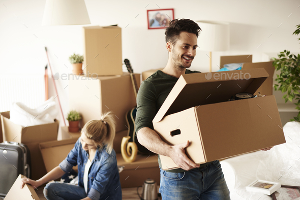 Young couple moving in to house - Stock Photo - Images