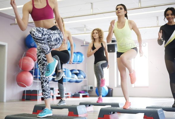 Step aerobics in health club - Stock Photo - Images