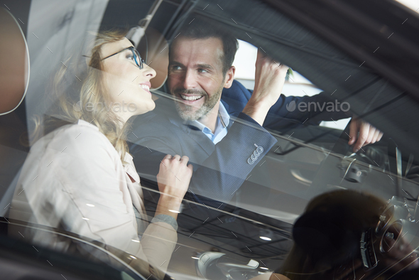Shot through the car window of customers couple - Stock Photo - Images