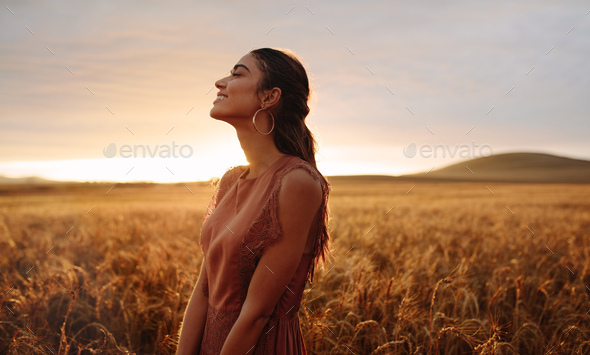 Happy woman enjoying in the nature - Stock Photo - Images
