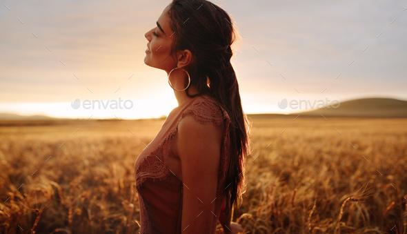 Woman enjoying countryside fresh air - Stock Photo - Images