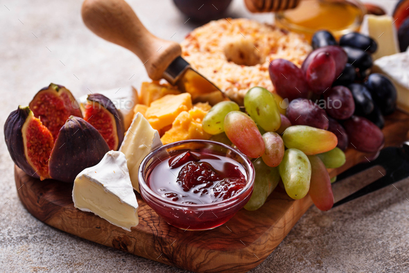 Appetizer for wine, cheese plate with grapes and figs - Stock Photo - Images
