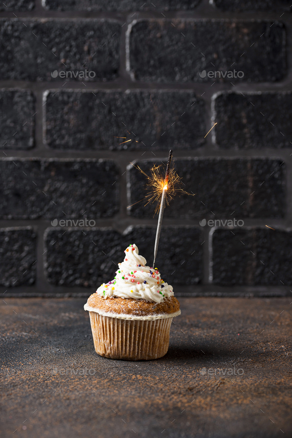 Birthday cupcake with cream and sparkler - Stock Photo - Images