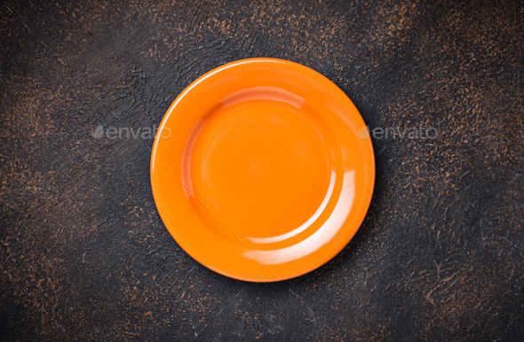 Empty plate on concrete table - Stock Photo - Images