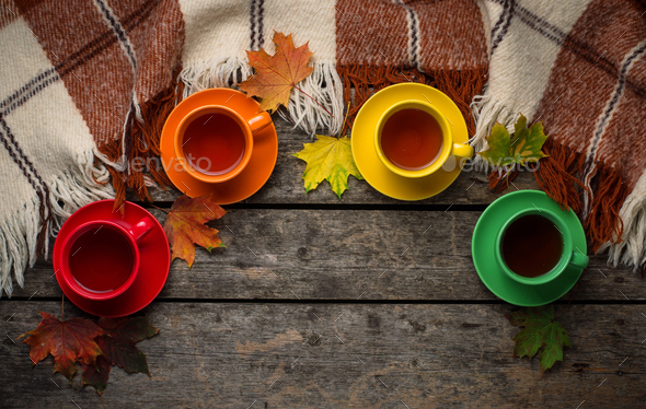 Autumn background with cup of tea, plaid and leaves - Stock Photo - Images