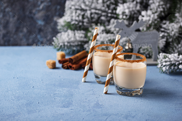 Traditional Christmas winter drink eggnog in glasses - Stock Photo - Images