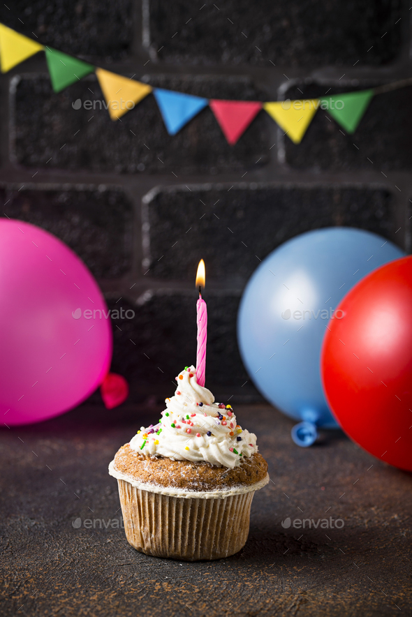 Birthday cupcake with cream and candle - Stock Photo - Images